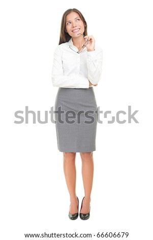 Thinking woman in white shirt happy pensive looking up at copy space. Isolated over white background. Mixed race Caucasian white / Chinese Asian.