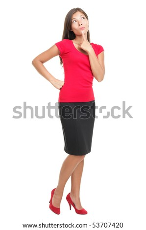 Thinking woman isolated on white background in full body / length. Beautiful young mixed race Asian / Caucasian business woman being pensive looking up