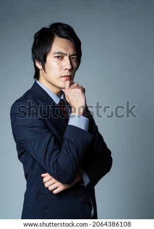 Thinking young asian businessman. Serious business concept.