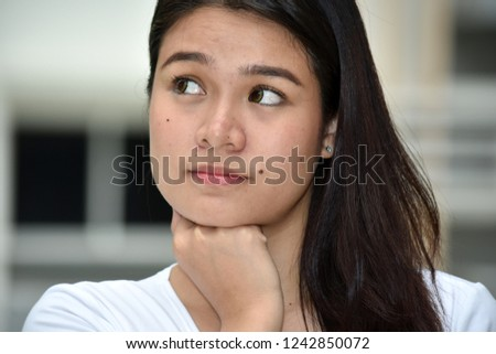 Thinking Young Asian Female #1242850072