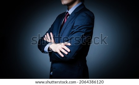 Thinking young businessman. Serious business concept.
