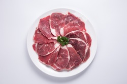 Thinly sliced beef served with hot pot