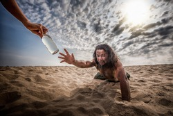 thirsty man in desert try to catch water bottle