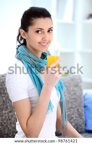 Thirsty young girl holding glass with  juice