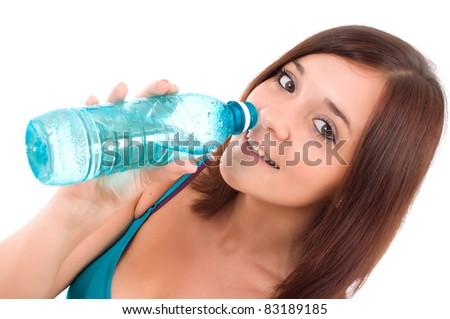Thirsty young women drinking water after fitness workout. Isolated on white
