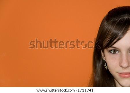 Thirteen years old teenage girl isolated on orange background