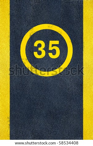 thirty five speed limit yellow road marking sign on asphalt road pavement