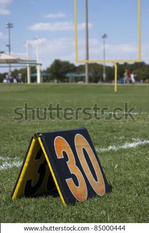 Thirty yard line marker on football field