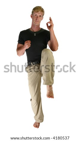Thirty year old man in street clothes doing self defense