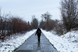 Thirty year old woman walking at the Ravel around Jodoigne in the snow