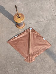 This a a picture of a kite and instrument to fly it. People fly kite during festivals to get fun and entertainment.