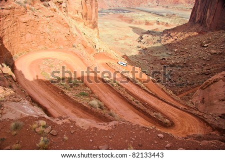 This  a steep portion of White Rim Road that runs from  Potato Bottom to Labyrinth in the Canyonlands National Park Utah.