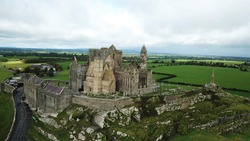 This aerial shot shows the rock of cashel, a historic site located in ireland.