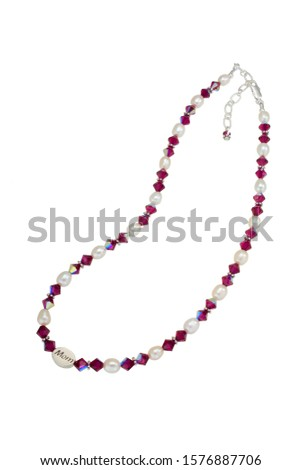 This beaded necklace is made up of freshwater pearls and red bicone glass crystles with silver findings. Mom stilver bead featured. Shown isolated on a white background. #1576887706