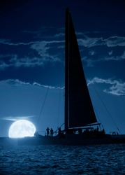 This beautiful photo illustration shows a large, blue moon rise off the coast of Key West Florida. A wine and sunset cruise on a beautifully calm Key West evening might also net you a moon rise.