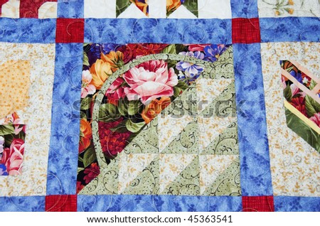 This beautiful quilt is handmade with sections of a basket with a view to the side in gorgeous pastels and florals.