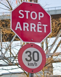 This bilingual stop sign in Vancouver, Canada, is written in French and English.