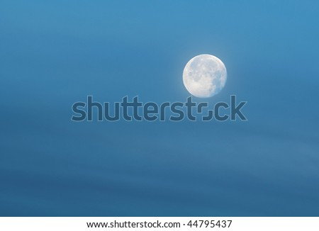 This bluish white full moon is set in a wispy airy blue sky.  This is the actual condition of the moon when this was shot.