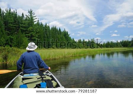 This canoer is heading up the Agnes River in Quetico Provincial Park