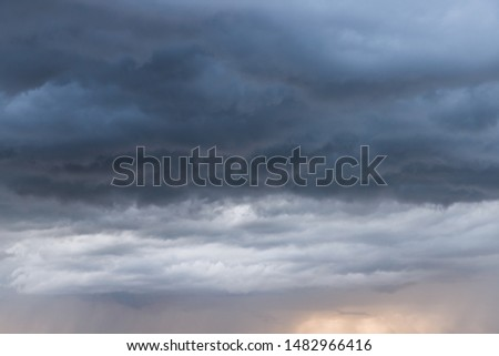 This colorful cloudscape has been photographed after a storm and during a sunset. #1482966416