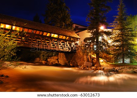 This covered bridge is lit up at night in Vail, Colorado, a popular summer and winter vacation destination for mountain bikers, skiers, and snowboarders.
