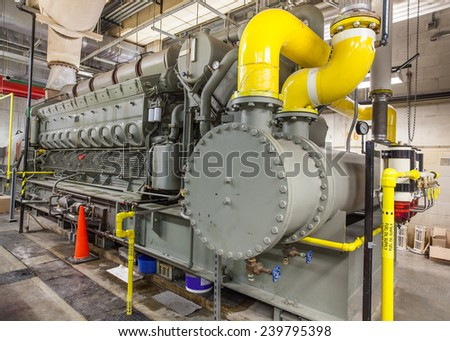 This diesel generator uses a locomotive engine as it\'s driver.   Stationary mounted in a building, hundreds of these are used on ships and oil rigs.