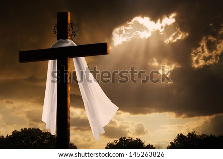 This dramatic lighting with storm clouds breaking and sunshine bursting through makes a great Easter photo illustration of Jesus dying on the cross and rising again.