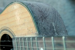 This guitar is very dirty. filled with dust. very artistic.