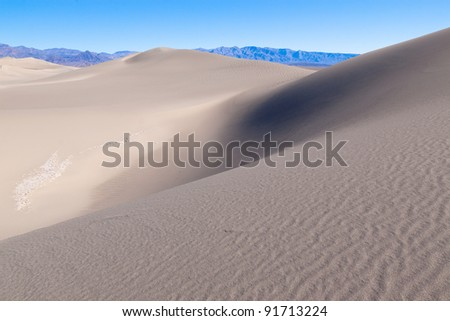 This image captures the interesting patterns of the Mesquite sand dunes in Death Valley National Park.