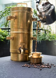 This image is about a traditional Indian coffee made from fresh roasted coffee beans served in a golden cup. The coffee is made in the city called Bangalore.