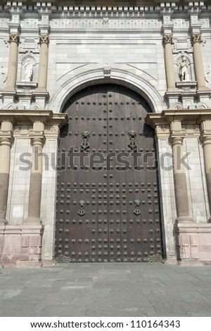 This image show a Cathedral Door near the Plaza Mayor, Lima, Peru