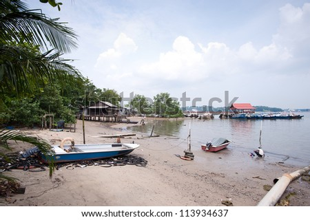 This image shows a Beach and wooden jetty on Pulau Ubin, Singapore