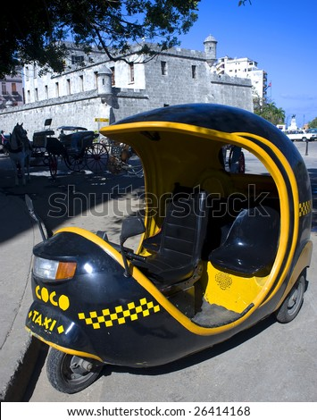 This image shows a coco taxi in Havana, Cuba