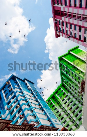 This image shows a colurful High Density Housing Block in Singapore