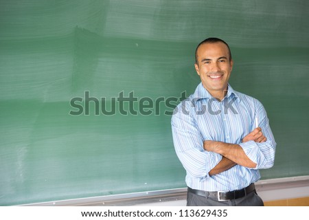 This image shows a Hispanic Male Teacher in his classroom