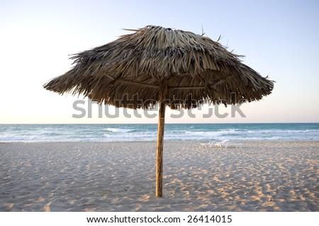 This image shows a lone beach umbrella at Varadero, Cuba