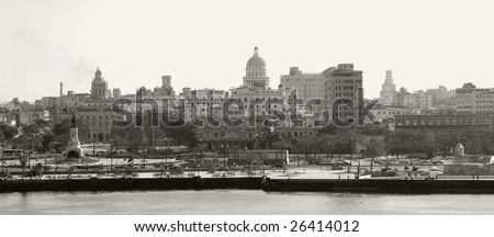 This image shows a panoramic sepia toned image of Havana's skyline.