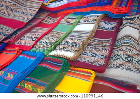 This image shows Bolivian textiles at a market.