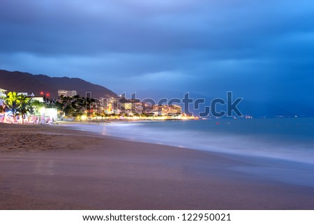 This image shows the beach at sunset in Puerto Vallarta, Jalisco, Mexico