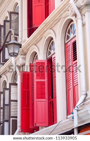 This image shows the colourful shutters of Singapore's Chinatown