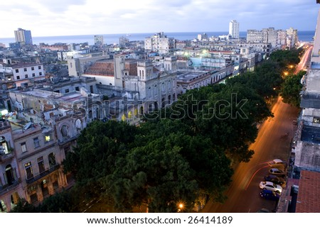 This image shows the night lights of Consulado Street, Havana, Cuba