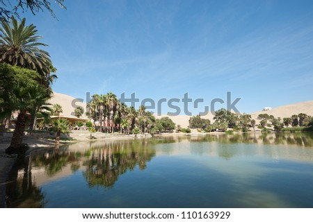 This image shows the oasis town of Huacachina, Peru