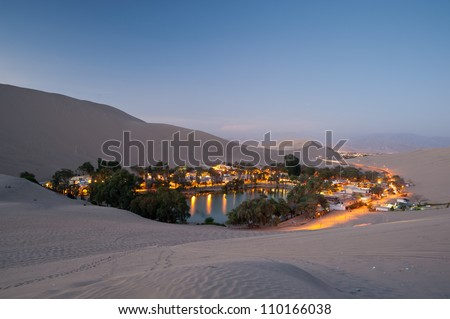 This image shows the oasis town of Huacachina, Peru at night