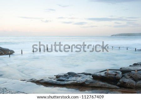 This image shows the shore line at Mahon Pool, Sydney, Australia - stock photo