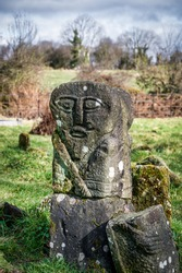 This is a bronze age stone carviing of a man on one side and a female on the other. They are located In Caldragh Cemetery on Boa Island, Lower Lough Erne. Northern Ireland