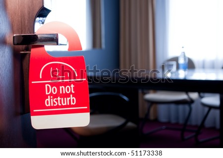 "This is a closeup of a ""do not disturb"" sign"