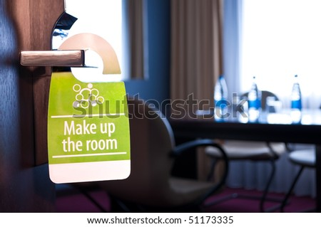 "This is a closeup of a ""make up the room"" sign"
