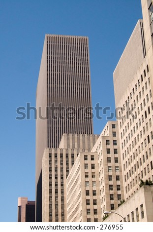 This is a detailed shot of a skyscraper in New York City against a rich blue sky.
