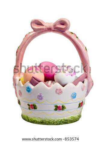 This is a drop-out white shot of a hand painted ceramic Easter basket with some colored eggs. - stock photo