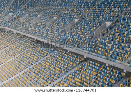 This is a field of empty stadium seats - Ukraine. Seats are painted a yellow and a blue.